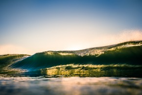 Beautiful sunrise over the ocean with wave at Byron Bay